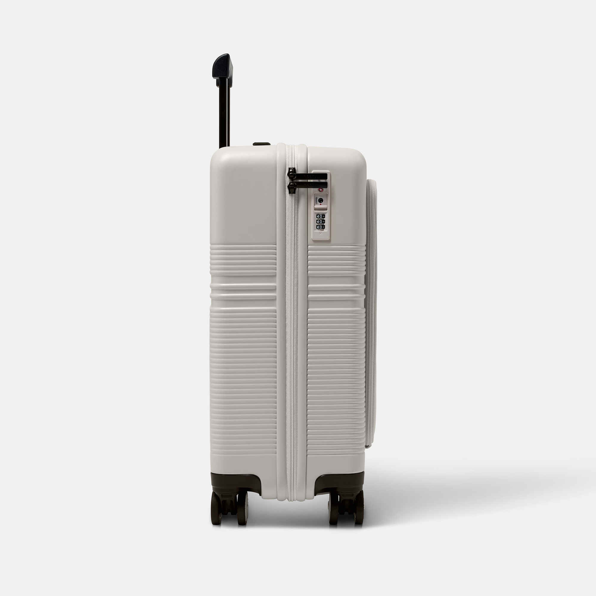 NORTVI sustainable design white suitcase with laptop compartment made of durable material. Perfect travel trolley to use as hand luggage.